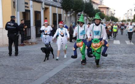 Mayores y pequeños corren en Manzanares por la Navidad